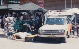 "Peter & Rosa's ""bakkie"" (truck) and vegetable stall."