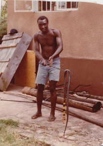 Peter holding the cobra I shot at our home in Musoma, TZ