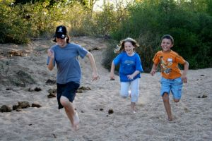 Foot race in a dry riverbed, alongside elephant dung!